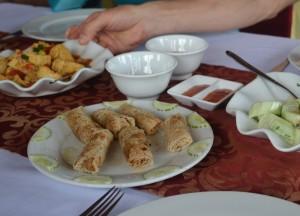 Eating Springrolls, Best Halong Bay Overnight Cruise Tours from Hanoi