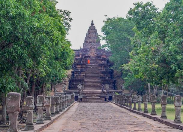 Monk Climbing Phanom Rung Steps, Isaan Tours Thailand